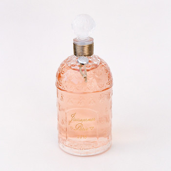 peach glass perfume bottle