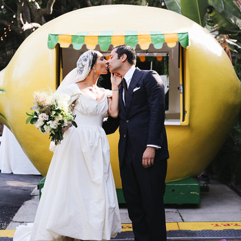 pia davide wedding couple in front of lemon vehicle