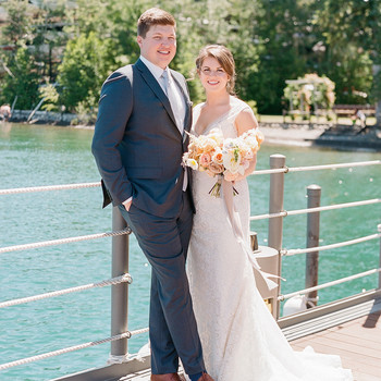 bride groom pose on lake dock forrest background