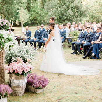 bride and groom standing outdoor wedding ceremony