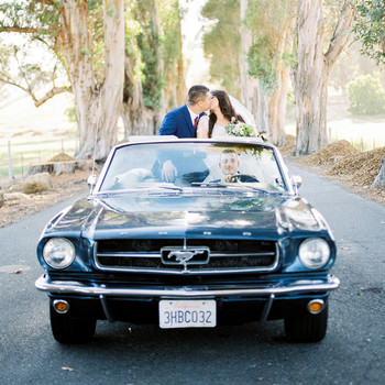 erika evan wedding couple kiss in mustang