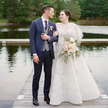 bride and groom standing on dock