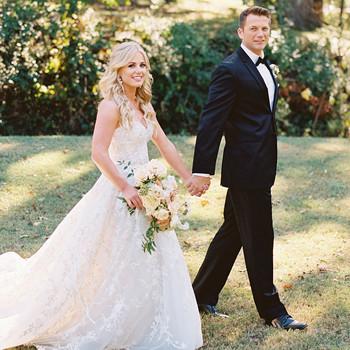 bride groom walking outdoors holding hands