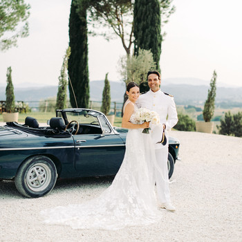 kseniya sadhir wedding couple posing in front of vintage car