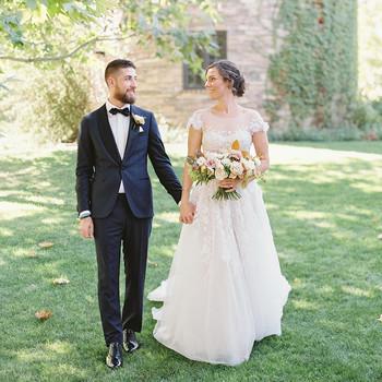 sam kyler wedding couple standing outside stone building