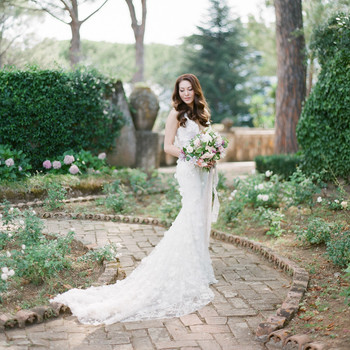 adrienne cameron wedding bride standing in garden
