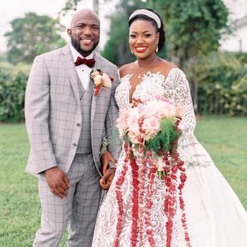 bride and groom stand for wedding portrait outside