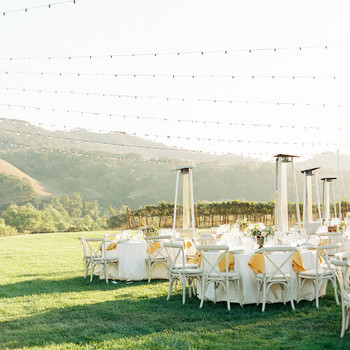 outdoor vineyard venue wedding reception under bistro lighting