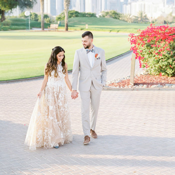 wedding couple hand in hand outdoor Dubai