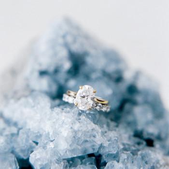 wedding rings displayed on blue crystal