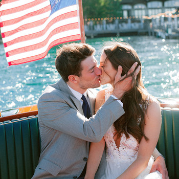 wedding couple kiss boat ride