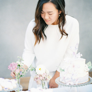 bride holding flowers at pastel shower