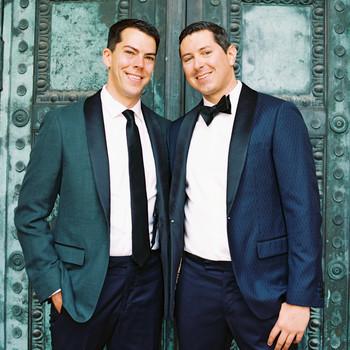 wedding couple in front of emerald doors