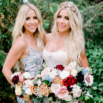 bride posing with her twin sister