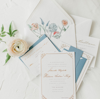 blue and white stationery with floral liner