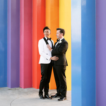 jason justin wedding couple in front of rainbow wall