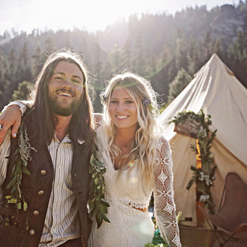 wedding couple bouquet tent near woods