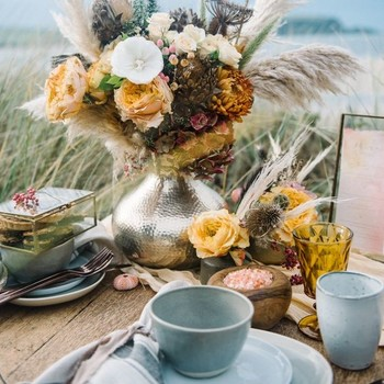 beach wedding ideas table setting on beach with sea urchin decor