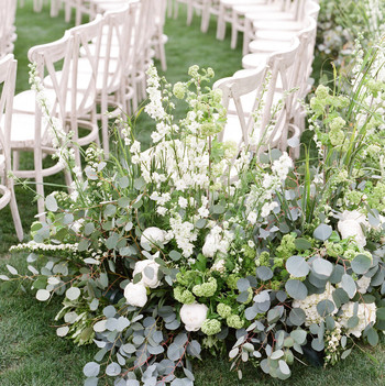 last row ceremony chair decorations eucalyptus and white roses
