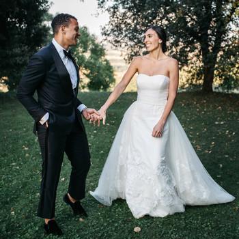 sara sam italy wedding couple holding hands