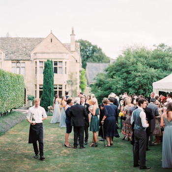 guests gather for cocktail hour at the gardens at Fifield manor