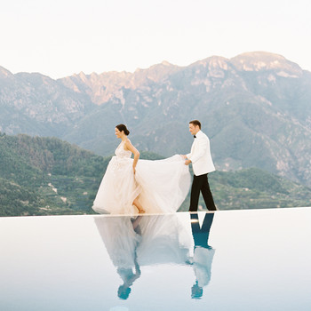 jacqueline david wedding couple walking by infinity pool