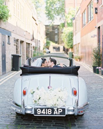 Wedding car kiss