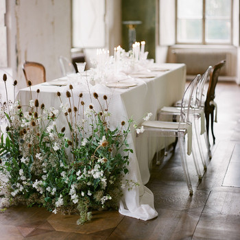 restaurant wedding ideas table with floor floral arrangement