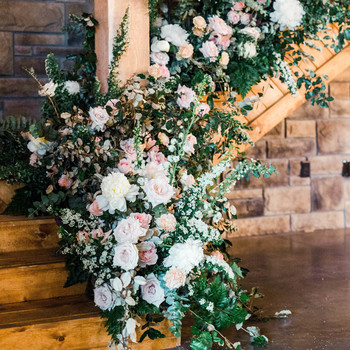 wood stairwell floral arrangement