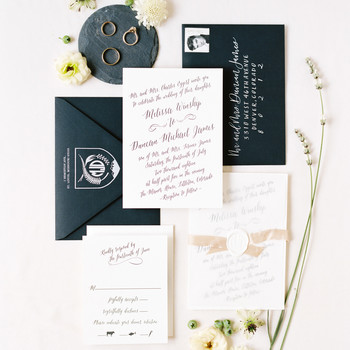 black and white stationary with elegant script writing