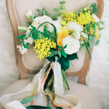 White and Yellow Bouquet on a Chair