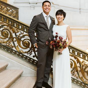 bride groom pose on stairway decorative gold railing