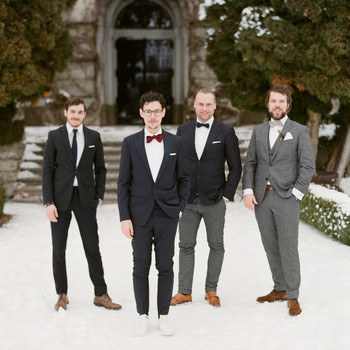 winter wedding guest attire groom and groomsmen in suits