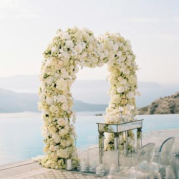 angie prayogo greece wedding outdoor ceremony arch