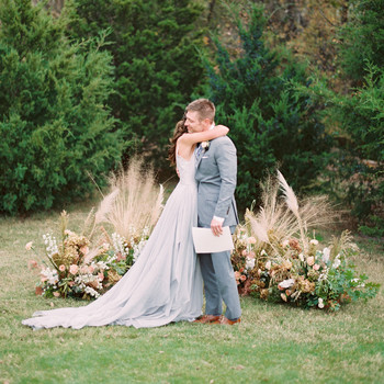 bride groom outdoor ground floral arches