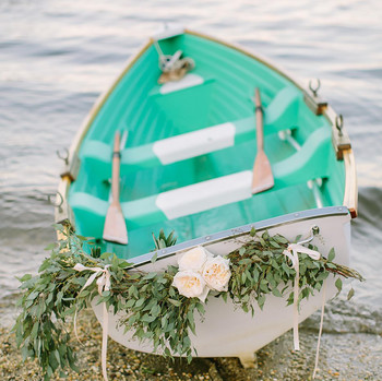 Boat with greenery garland