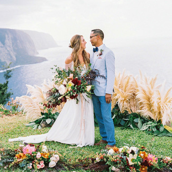 rebecca eryck wedding hawaii couple gaze cliff
