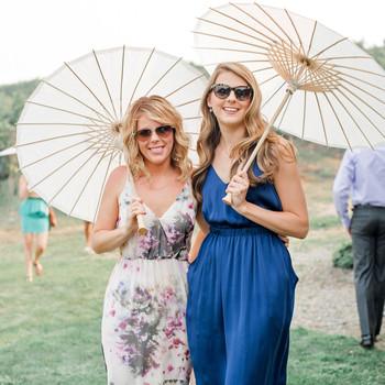 summer wedding guests sleeveless dresses parasols