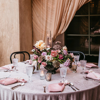 reception space pink linens and drapery with floral centerpiece