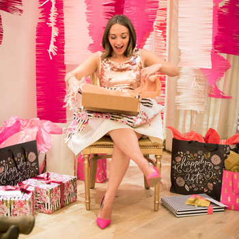 woman opening bridal shower gifts