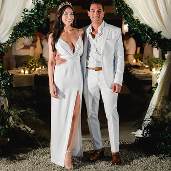 couple standing in rehearsal dinner tent entry way