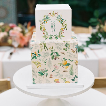 cubed wedding cake with flora-and-fauna-centric illustrations