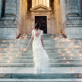 bride walking up lighted stairway