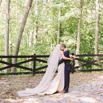 ashley and justin embrace in woods