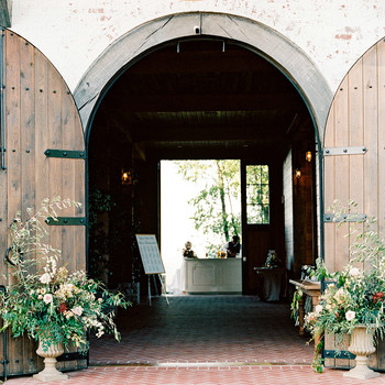 Claire and Dan's wedding reception venue entrance with doors open