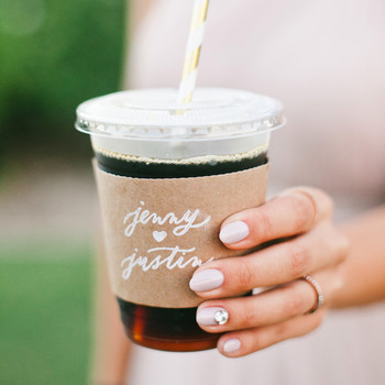 coffee wedding ideas woman holding iced beverage with couple names sleeve