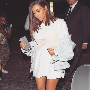 Kim Kardashian in a t-shirt and corset