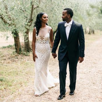veronica mickias wedding couple holding hands near trees