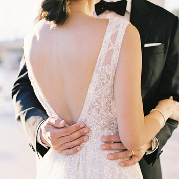 sze amanzoe wedding couple embrace greece elegant