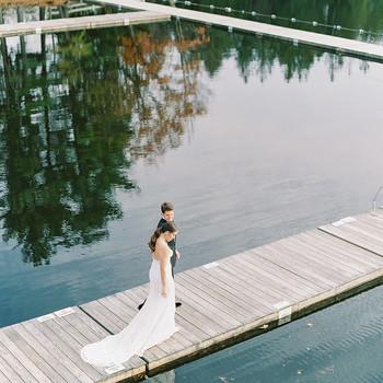 elizabeth nicholas wedding couple walking along boardwalk
